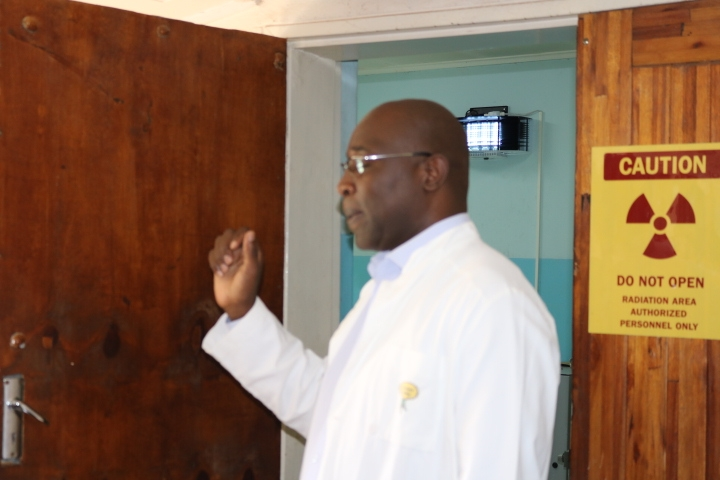 Mr. Deus Nkhota welcoming the NEPAD team to the x-ray room at Kamuzu Central Hospital