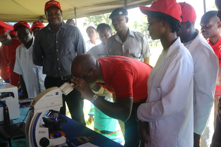The Minister appreciating how microscopes work at the Laboratory pavillion