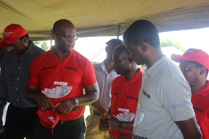 The Minister interacting with the Secretary for Health and The TB Programs Manager, Dr. James Mpunga